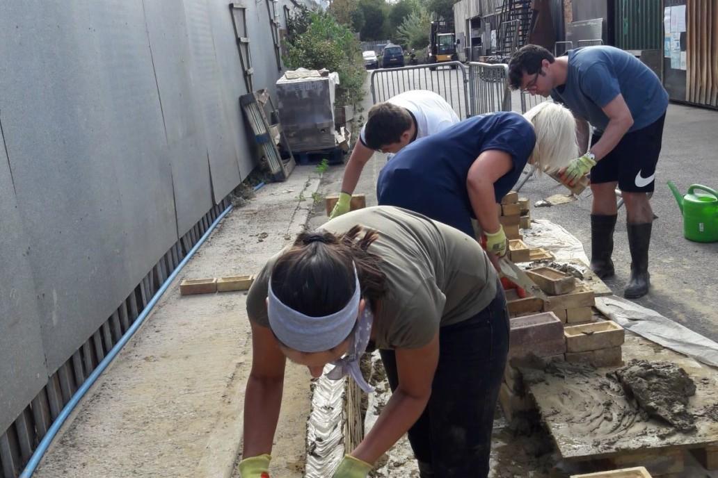 Laying bricks at Cody Dock