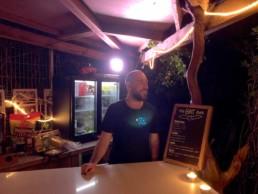 Mark serving at the bar